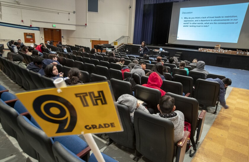 Reseda High School vice principal Phyllis Castaneda clicks through a slide presentation in the campus auditorium as students at the school are in the school auditorium and gym as UTLA teachers are out on strike in Reseda.