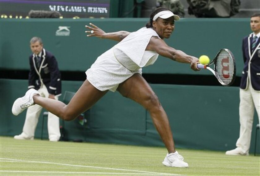 Venus Williams of the US in action during the match against Japan's Kimiko Date-Krumm at the All England Lawn Tennis Championships at Wimbledon, Wednesday, June 22, 2011. (AP Photo/Kirsty Wigglesworth)