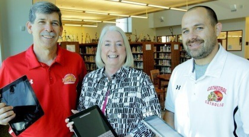 Cathedral Catholic staff members Sean Doyle, director of institutional advancement and alumni; Rosemary Burson, assistant director for the Center of Innovation; and Dustin Nies, director of technology, instruct educators at the iPad Institute.