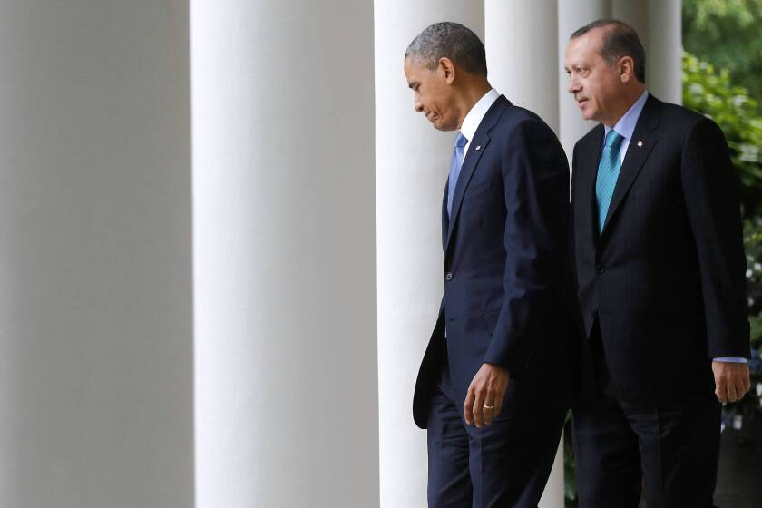 President Obama and Turkish Prime Minister Recep Tayyip Erdogan walk to the White House Rose Garden for their news conference. Erdogan's visit was aimed at appealing to Obama to sharply increase pressure on the government of Syria.