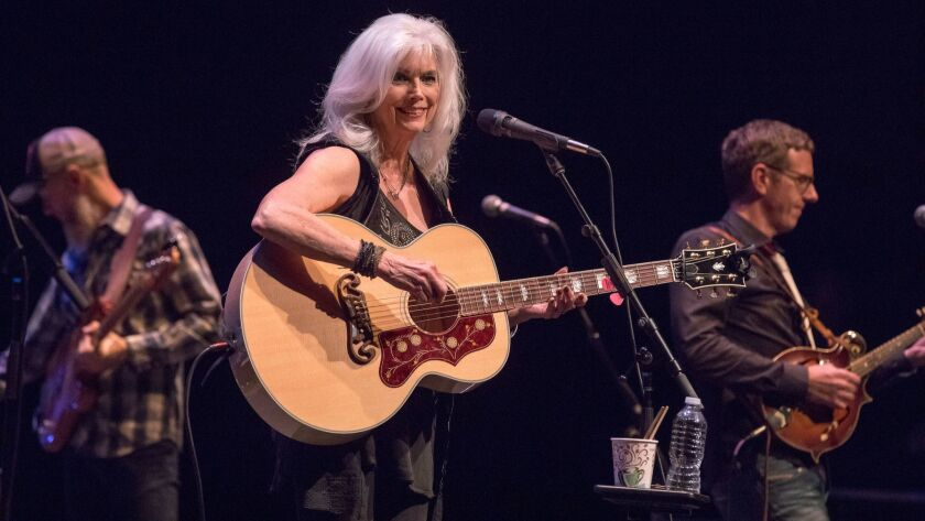 Emmylou Harris on Thursday at UCLA's Royce Hall, shown with bassist Chris Donohue, left, and mandolinist Eamon McLoughlin.