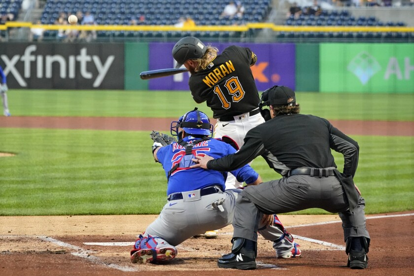 Pittsburgh Pirates' Colin Moran (19) hits a three-run home run off Chicago Cubs starting pitcher Alec Mills in the first inning of a baseball game in Pittsburgh, Tuesday, Sept. 28, 2021. (AP Photo/Gene J. Puskar)