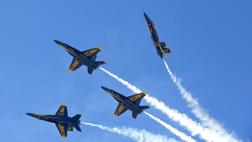 The Navy Blue Angels perform high speed flight maneuvers for the crowd at the Miramar Air Show in 2014.  (Nelvin C. Cepeda)