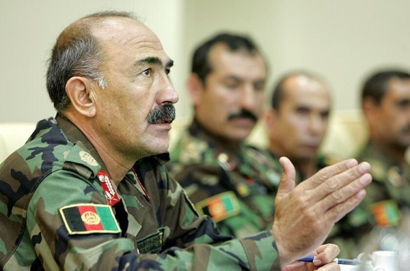 Afghan army Brig. Gen. Muhaiuddin Ghori responded to a reporter's question via an interpreter yesterday at a news conference at Camp Pendleton's Staff NCO Club.