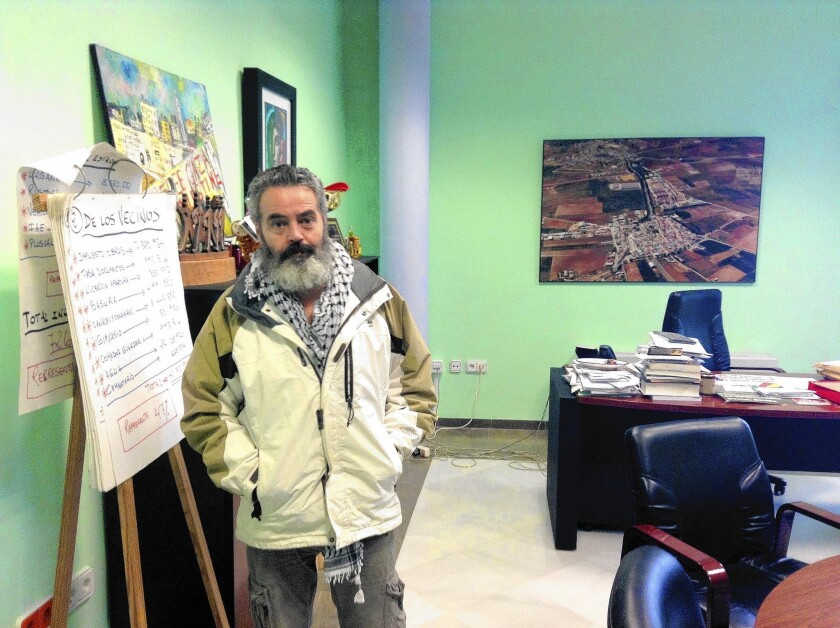 Mayor Juan Manuel Sanchez Gordillo of Marinaleda, Spain stands in his office after working on the town budget. He may face jail time after leading a raid on a supermarket in a neighboring town, in which he and others took food to donate to food banks.