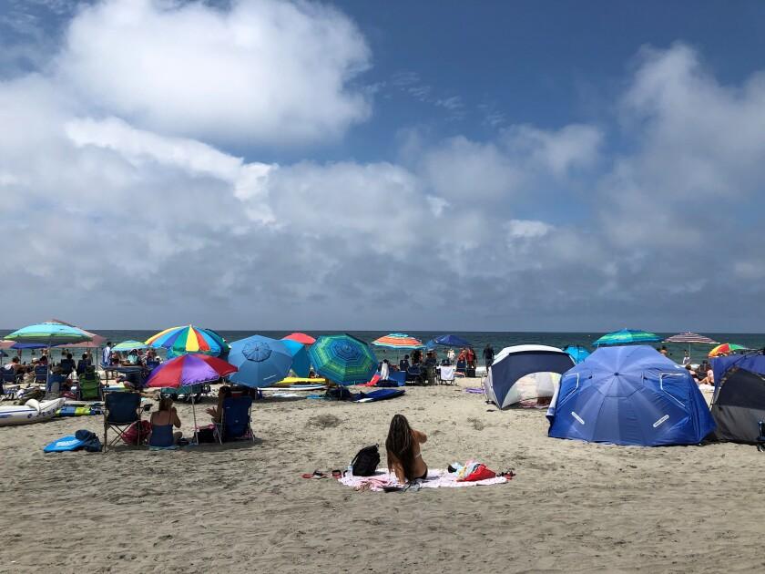 Colorful umbrellas shield beach-goers at La Jolla Shores.