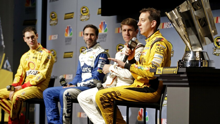 Kyle Busch, right, talks to reporters alongside fellow NASCAR drivers, from left, Joey Logano, Jimmie Johnson and Carl Edwards during a news conference Thursday.