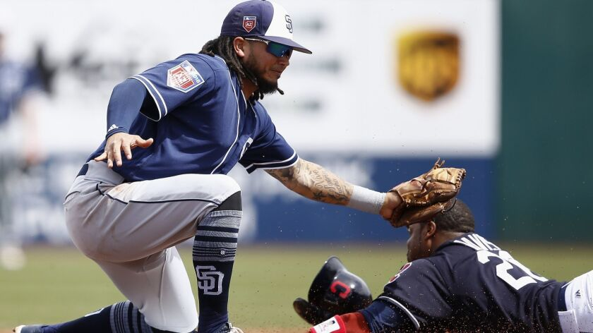 Cleveland Indians' Rajai Davis, right, steals second base ahead of a tag from San Diego Padres short