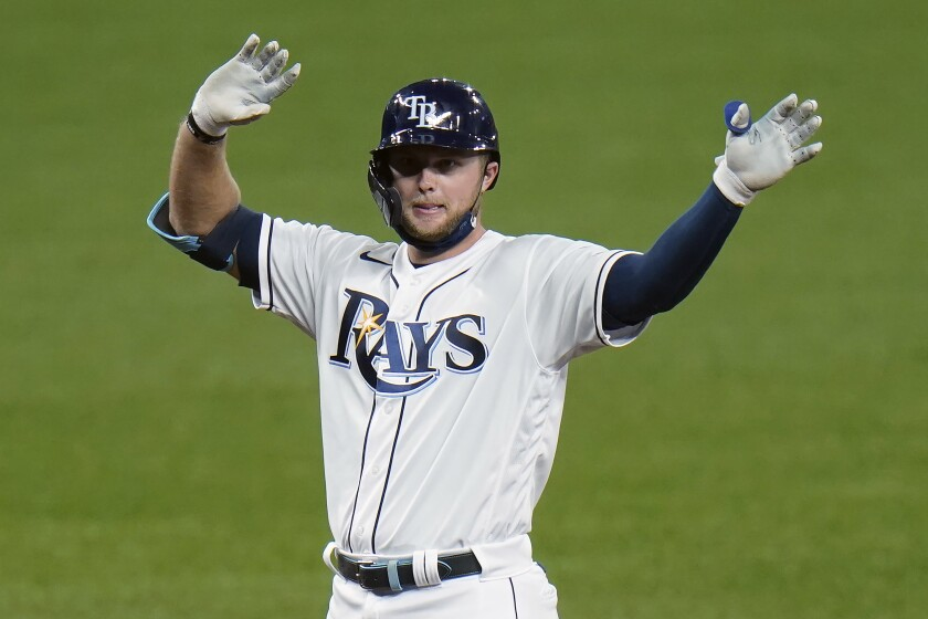 Tampa Bay Rays' Austin Meadows celebrates his RBI double off Boston Red Sox relief pitcher Ryan Weber during the fifth inning of a baseball game Thursday, Sept. 10, 2020, in St. Petersburg, Fla. Rays' Manuel Margot scored on the hit. (AP Photo/Chris O'Meara)