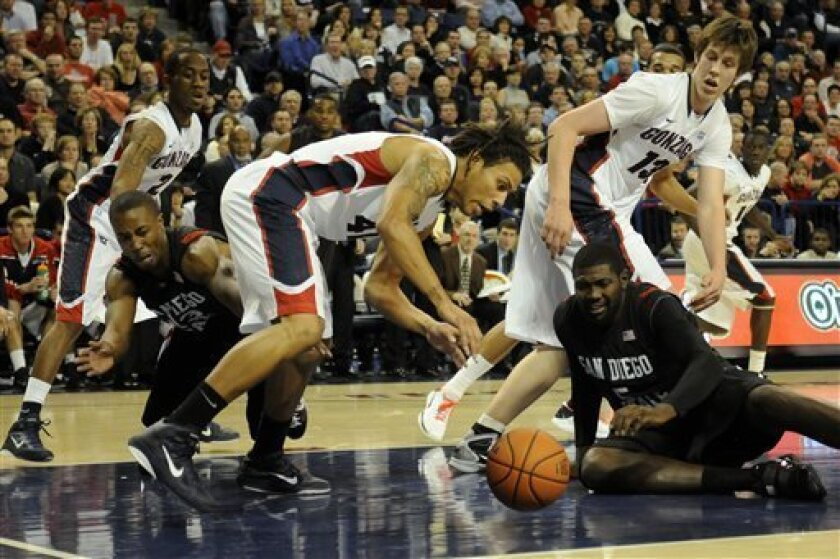 Gonzaga's Steven Gray (41) scrambles to pick up a loose ball as from left to right Gonzaga's Marquise Arop (2), San Diego St's D.J. Gay, Gonzaga's Kelly Olynk (13) and San Diego St's Brian Carlwell (5) watch in the first half of an NCAA college basketball game, Tuesday, Nov. 16, 2010, in Spokane, W