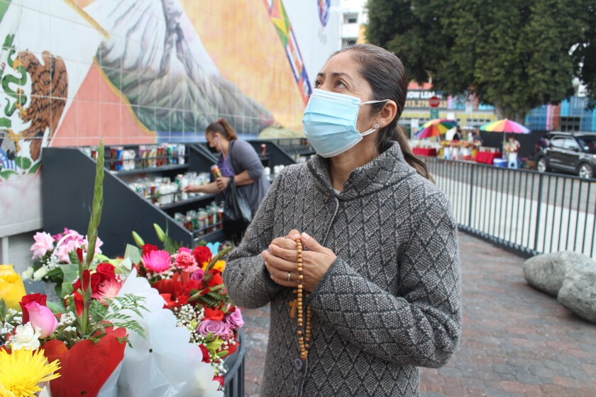 Rosalía González visited Olvera Street and prayed before the Virgen de Guadalupe with native Mexican San Juan Diego.