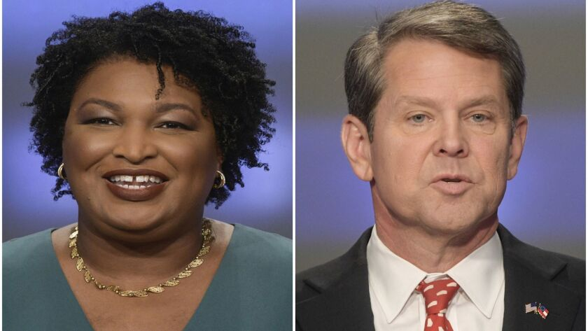 File-This combination of May 20, 2018, file photos shows Georgia gubernatorial candidates Stacey Abr