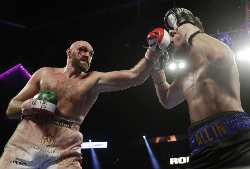 Tyson Fury, left, punches Otto Wallin during their heavyweight boxing match in Las Vegas on Saturday.