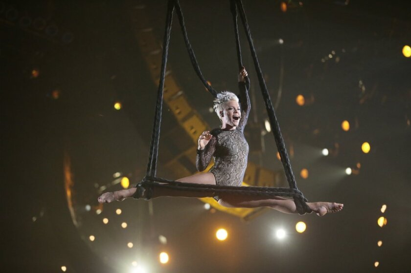Will Pink, shown at the 2014 Grammy Awards, bring her acrobatic ways to the Oscars?