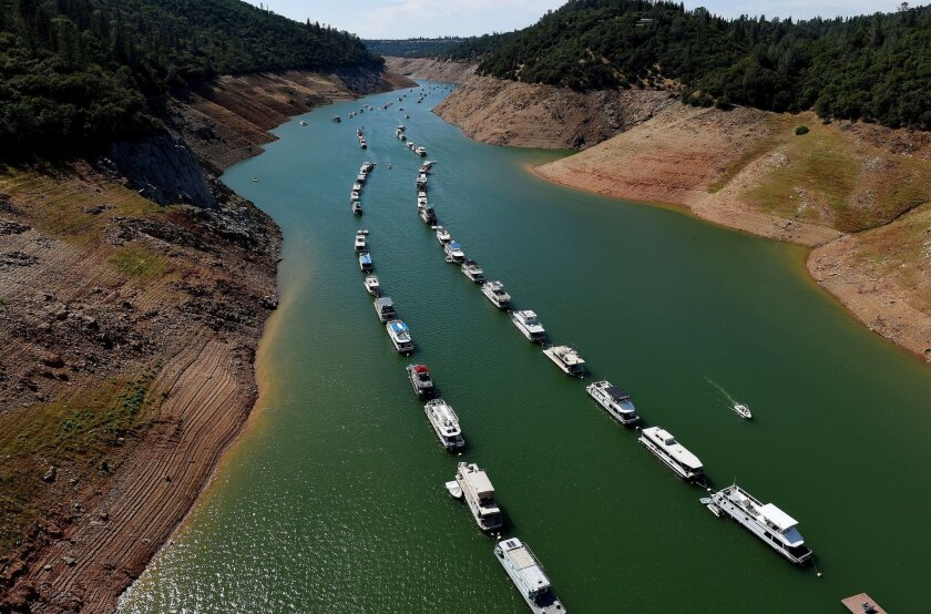 Houseboats are moored on a shrinking arm of the Oroville Lake reservoir, which is now at 25% capacity because of the drought.