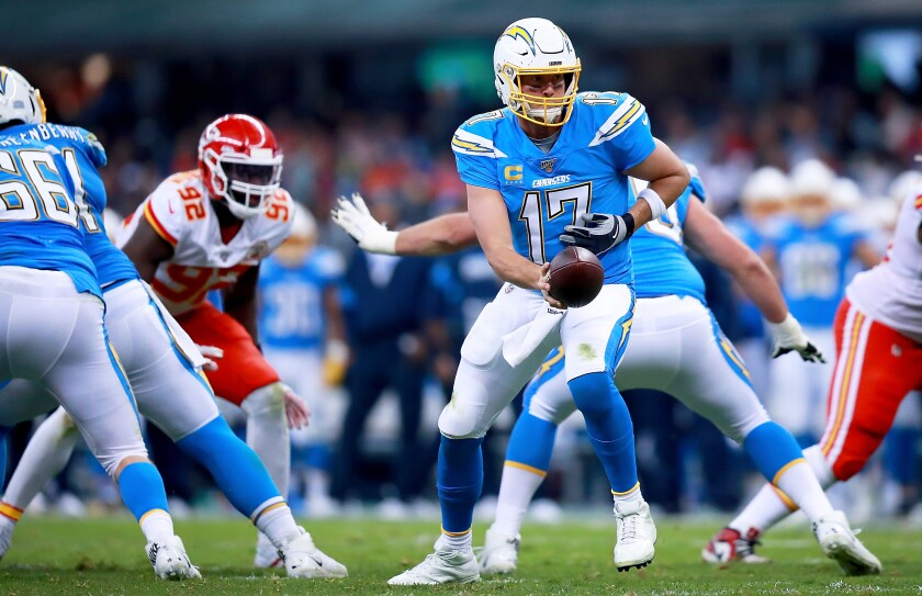 Chargers quarterback Philip Rivers hands off the ball against the Chiefs.