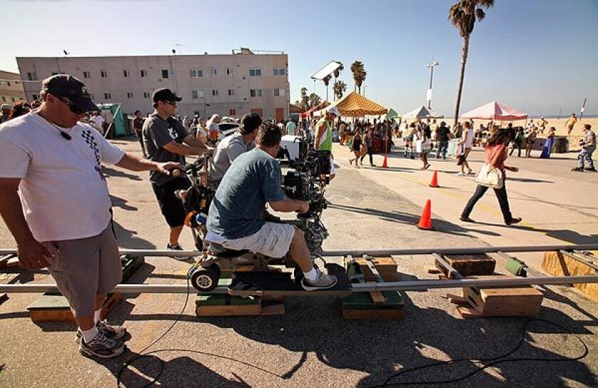 "Camera operator Fred Iannone moves on a camera dolly during shooting for ""NCIS: Los Angeles."""