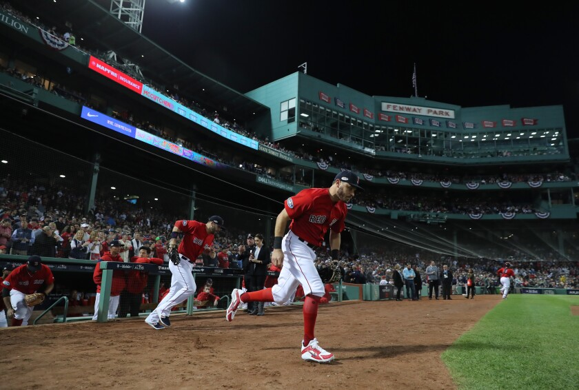 The Boston Red Sox take the field at Fenway Park on Oct. 6, 2018.