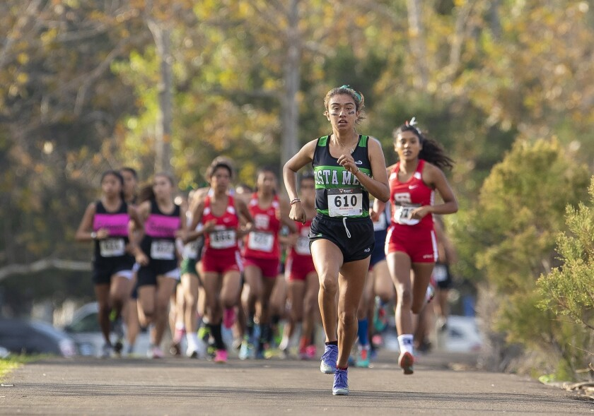 Costa Mesa's Diane Molina leads the pack during the Orange Coast League cross-country finals at Irvi