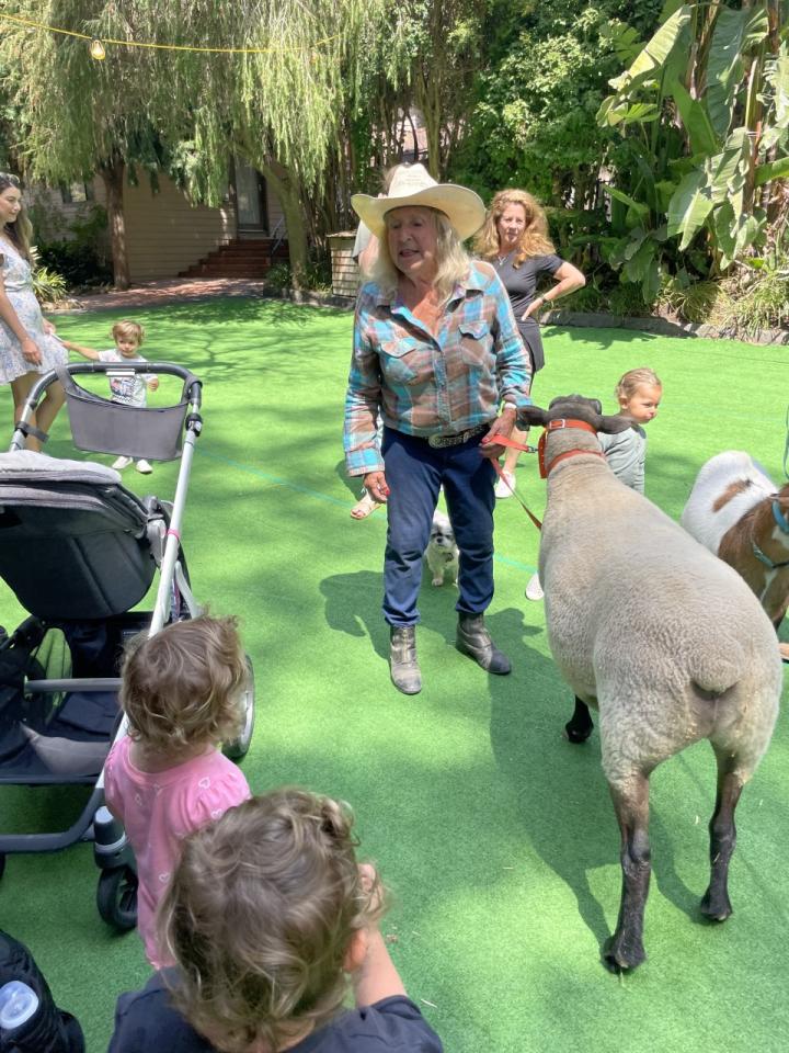 "Pam sings ""Baa Baa White Sheep"" to the children."