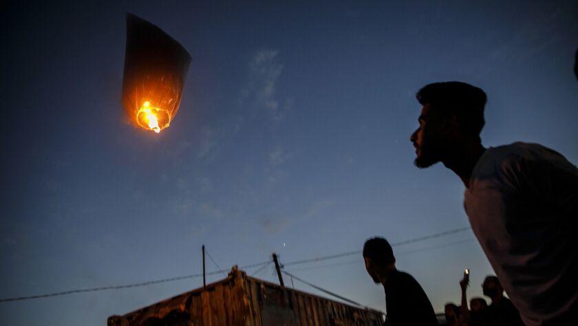 DEIR AL-BALA, GAZA STRIP -- WEDNESDAY, MAY 9, 2018: Palestinians spend their afternoons watch kites