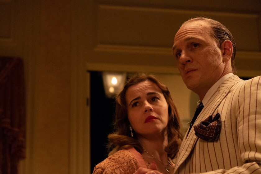 """Linda Cardellini and Tom Hardy in the movie """"Capone."""""""