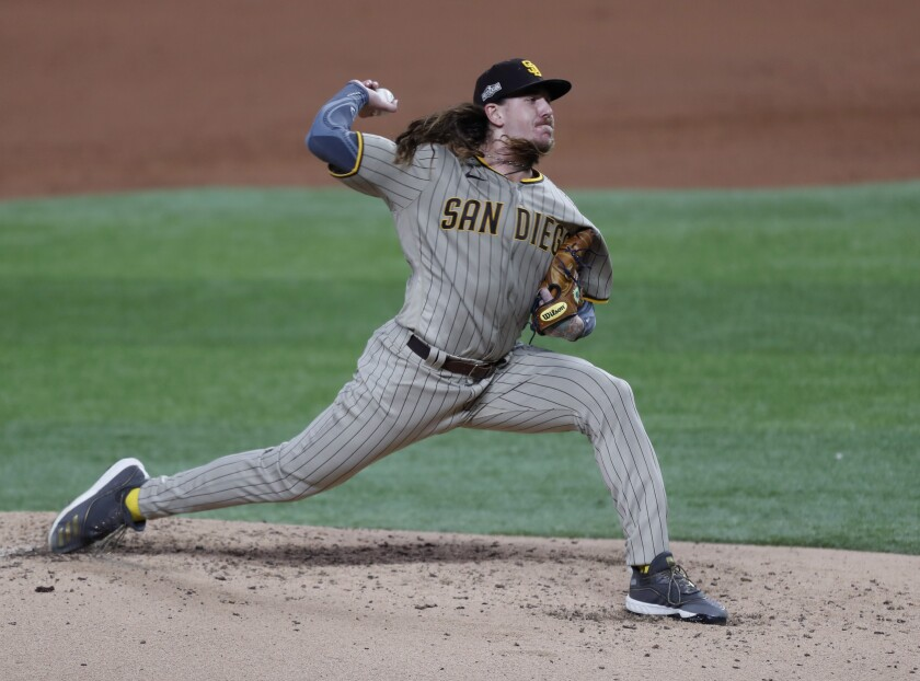 Mike Clevinger throws his final pitch, in the second inning, against the Dodgers in Game 1 of the NLDS.