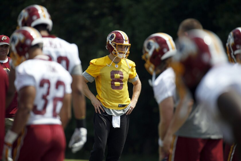 Washington Redskins quarterback Kirk Cousins (8) stands during practice at the team's NFL football training facility at Redskins Park, Wednesday, June 1, 2016 in Ashburn, Va. (AP Photo/Alex Brandon)