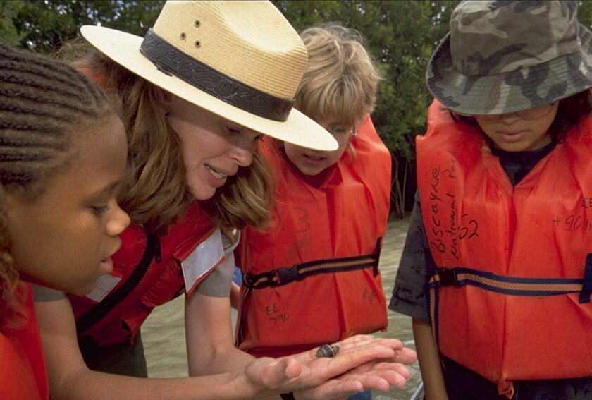 Children and a ranger examine shells at Biscayne National Park near Miami.