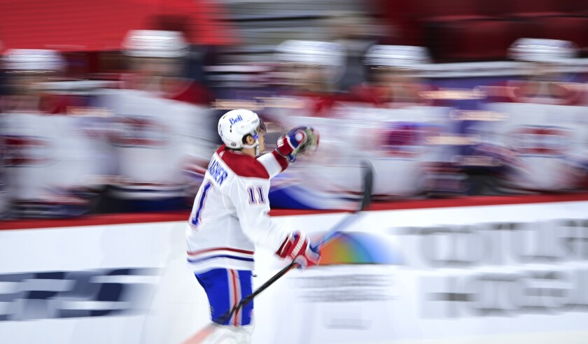 Montreal Canadiens' Brendan Gallagher (11) celebrates a goal against the Ottawa Senators as he skates past the bench during the third period of an NHL hockey game Thursday, April 1, 2021, in Ottawa, Ontario. (Sean Kilpatrick/The Canadian Press via AP)