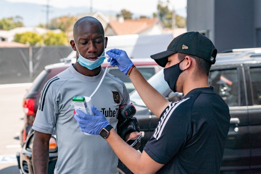 LAFC forward Bradley Wright-Phillips gets his temperature checked before taking part in Thursday's training session.