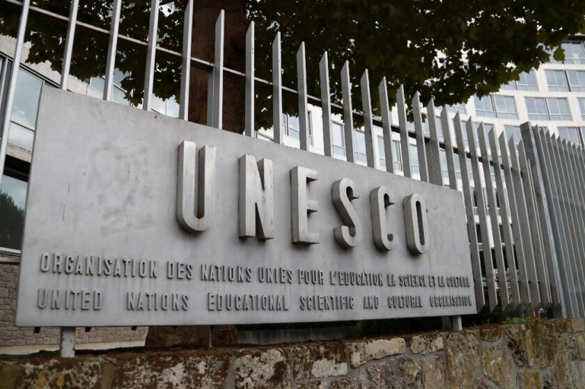 A picture taken on October 12, 2017 shows the logo of the United Nations Educational, Scientific and Cultural Organisation (UNESCO) headquarters in Paris.