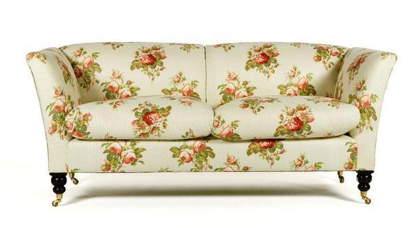 Picture the rose print and brass castors in a sleek white contemporary room, and suddenly the granny style has a completely different effect. The sofa is one of several high-end George Smith sofas poised to be steals in the Oprah auction. Estimated to sell for: $600 to $800 Current high bid: $500