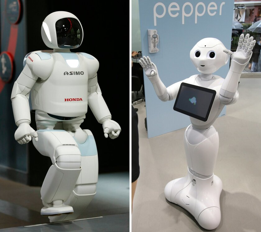 FILE  - This combination of file photos taken on July 3, 2013, left, and June 6, 2014 both in Tokyo shows Japanese automaker Honda Motor Co.'s walking robot Asimo, left, and Japanese internet company SoftBank's humanoid robot Pepper. Is Asimo marrying Pepper? Honda and SoftBank said Thursday, July