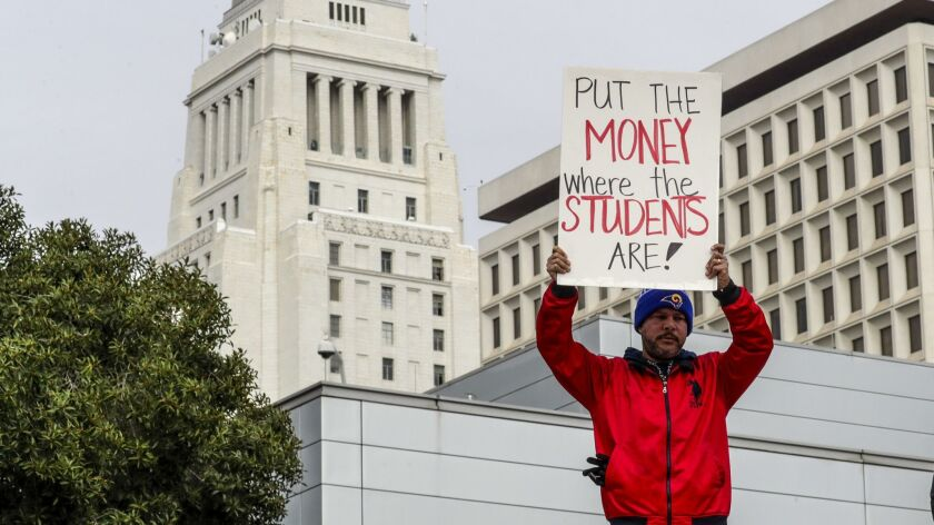 A United Teachers Los Angeles rally outside California Charter School Association offices in Los Angeles during the recent strike. (Los Angeles Times)