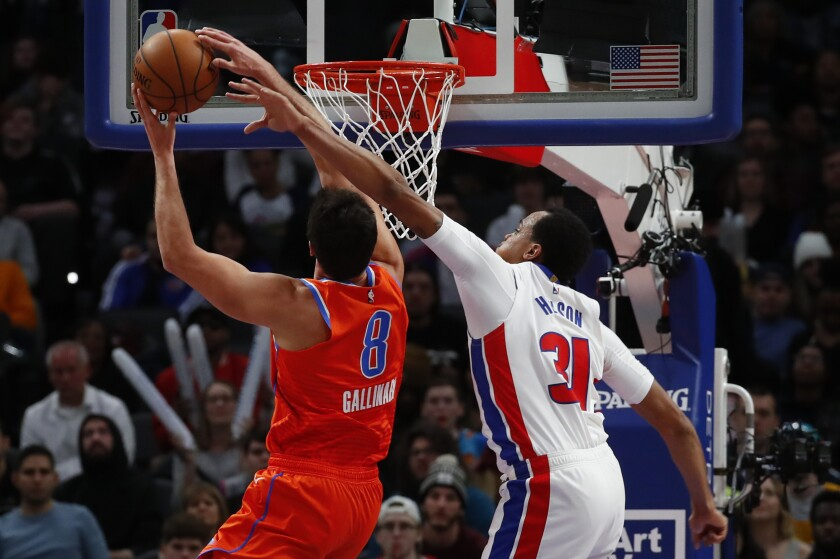 Oklahoma City Thunder forward Danilo Gallinari (8) drives on Detroit Pistons forward John Henson (31) in the first half of an NBA basketball game in Detroit, Wednesday, March 4, 2020. (AP Photo/Paul Sancya)