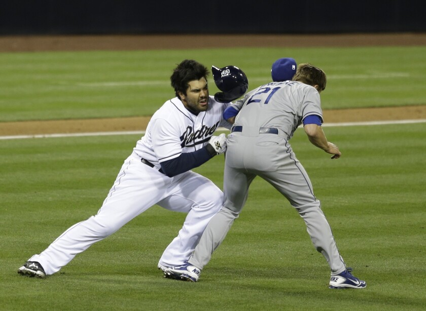 Dodgers pitcher Zack Greinke and Padres left fielder Carlos Quentin slam into each other when Quentin charged the mound after getting hit with a pitch.