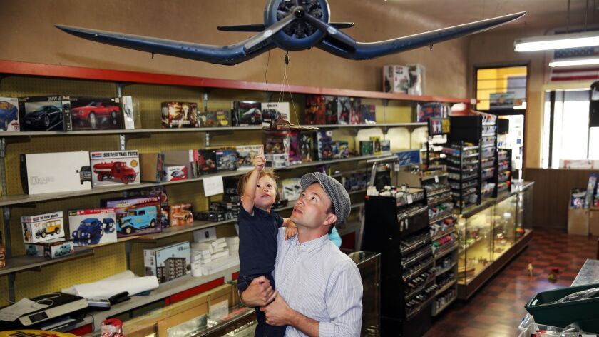 Colby Gomez, 2, and his dad, Tim Gomez, the great-grandson and grandson of Evett's Model Shop's owner.
