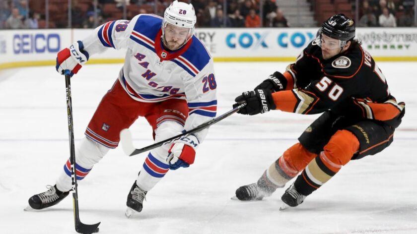 New York Rangers center Paul Carey vies for the puck with Anaheim Ducks center Antoine Vermette duri