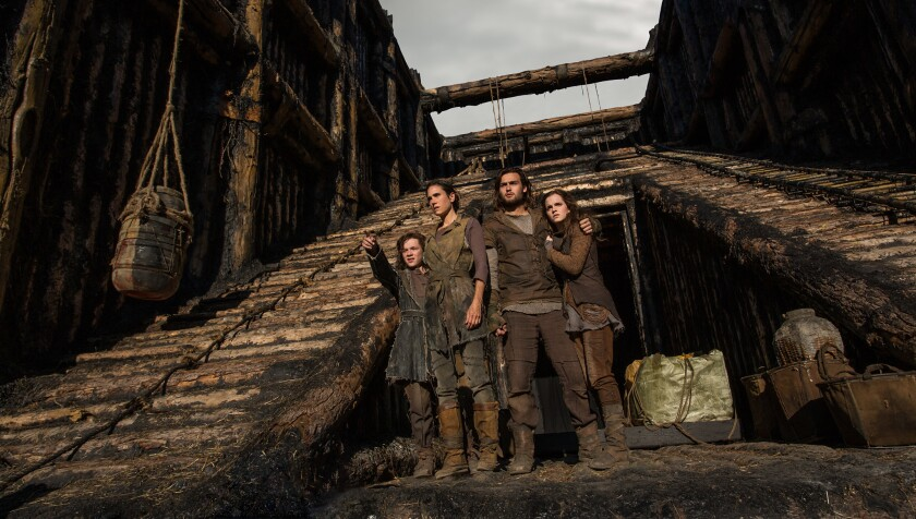 "Japheth (Leo McHugh Carroll), left, Naameh (Jennifer Connelly), Shem (Douglas Booth) and Ila (Emma Watson) in ""Noah."""