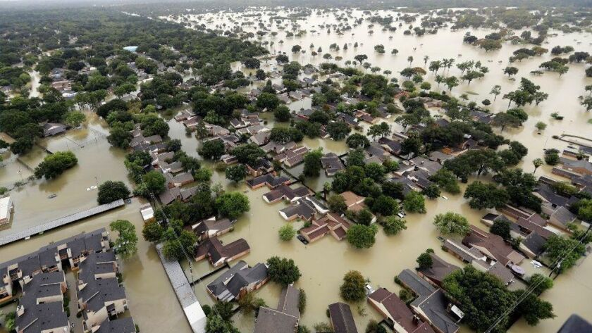 Water flows into neighborhoods of Houston in Aug. 29, 2017, as the area copes with Hurricane Harvey damage. Conroe, Texas, was similarly hit hard by flooding that left some homes a total loss, so property in the area can be hard to sell. One agent turned to scantily clad models.