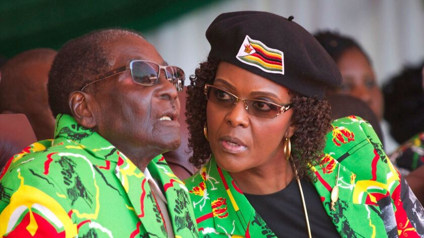 FILE - In this June, 2, 2017 file photo Zimbabwean President Robert Mugabe, left, and his wife Grace