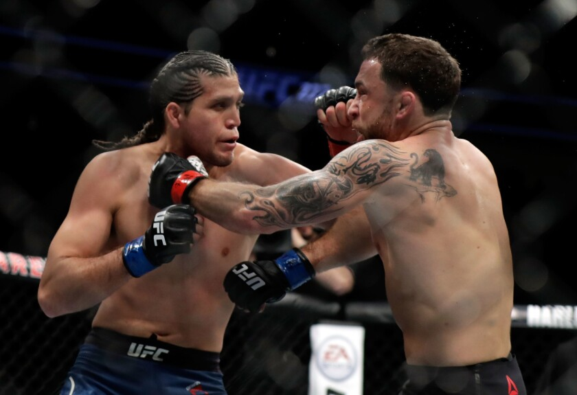 Brian Ortega fights Frankie Edgar during a featherweight bout at UFC 222 in March 2018.