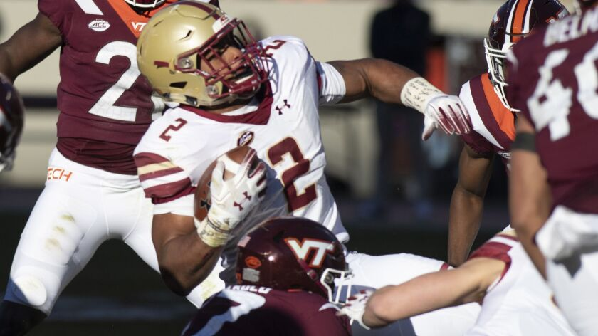 Boston College running back AJ Dillion is brought down during the first half of an NCAA college foo