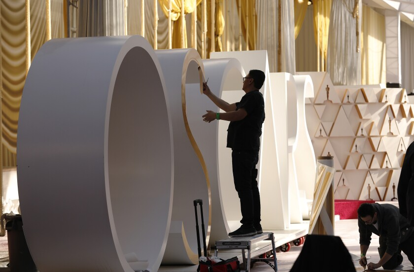 Preparations continue on the red carpet outside the Dolby Theatre for the 92nd Academy Awards.