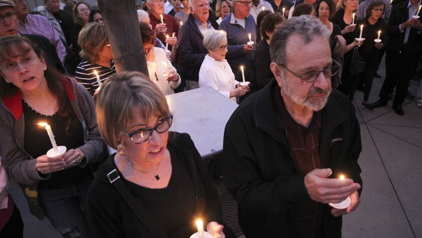 People from the community, many of them of various faiths, join members of the Rancho Bernardo Commu