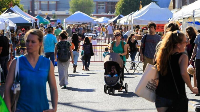 Crowds enjoy the North Park farmers market held every Thursday at 30th Street and North Park Way.