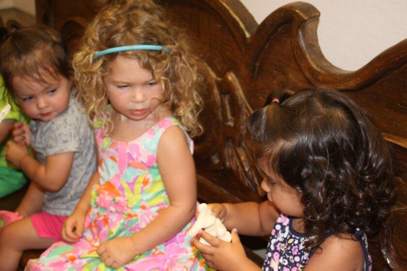 Georgia, Vera and Ana examine some coral up close.