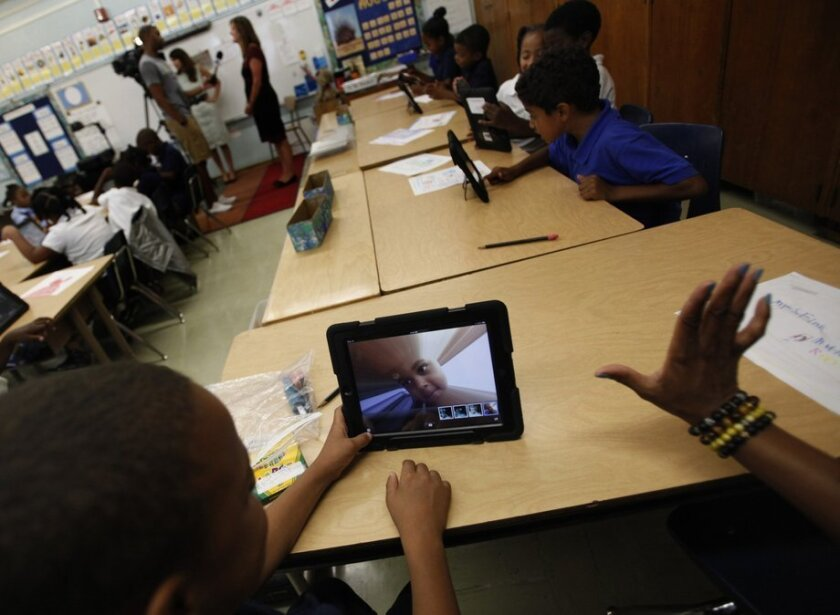 Students take to their new iPads at Broadacres Elementary School in Carson.