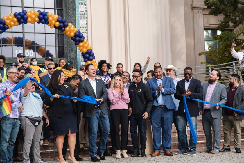 County Supervisor Nathan Fletcher cut the ribbon symbolizing the reopening of the county at County Administration Center